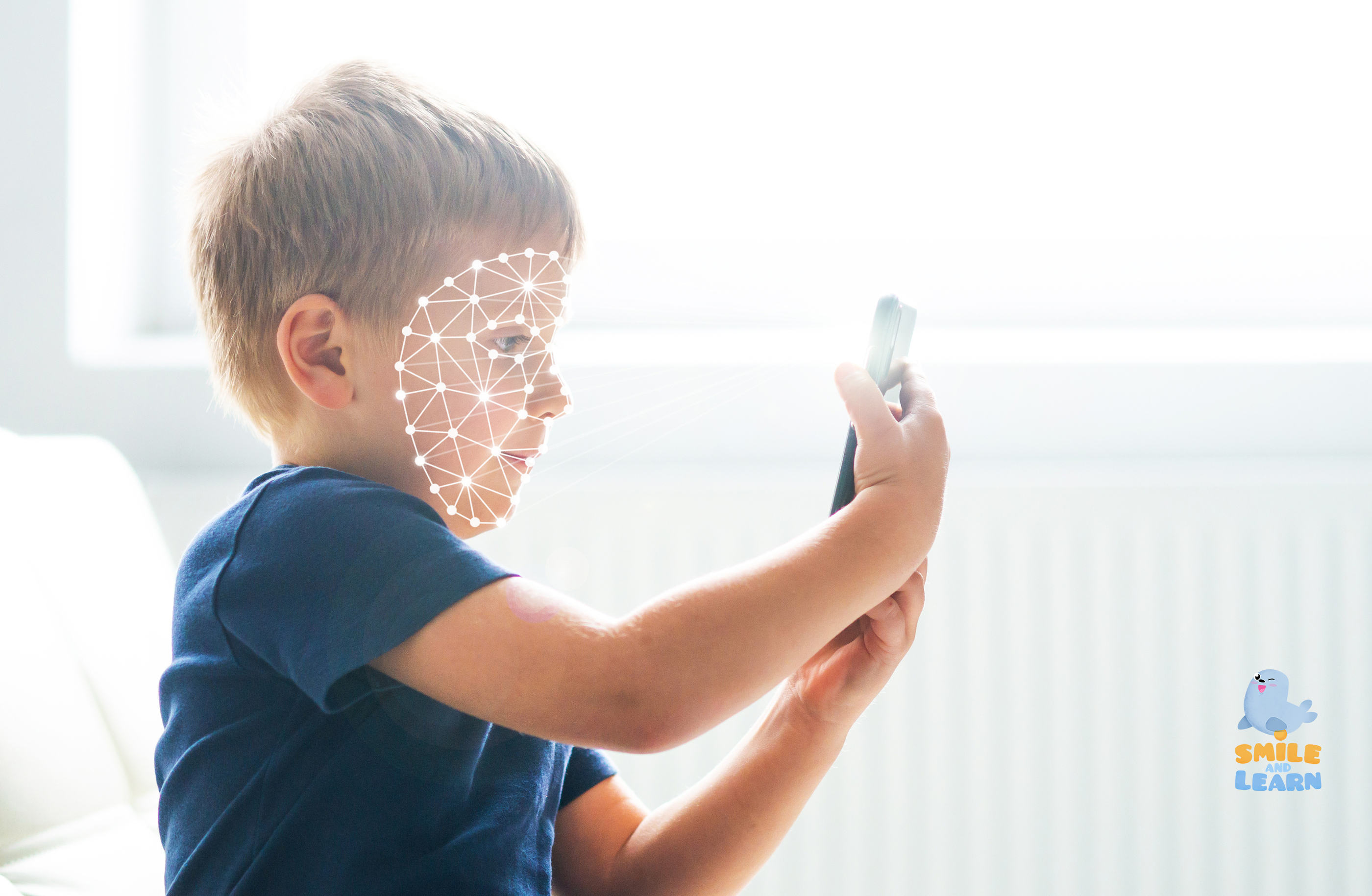 Kid using face id recognition. Boy with a smartphone gadget. Dig