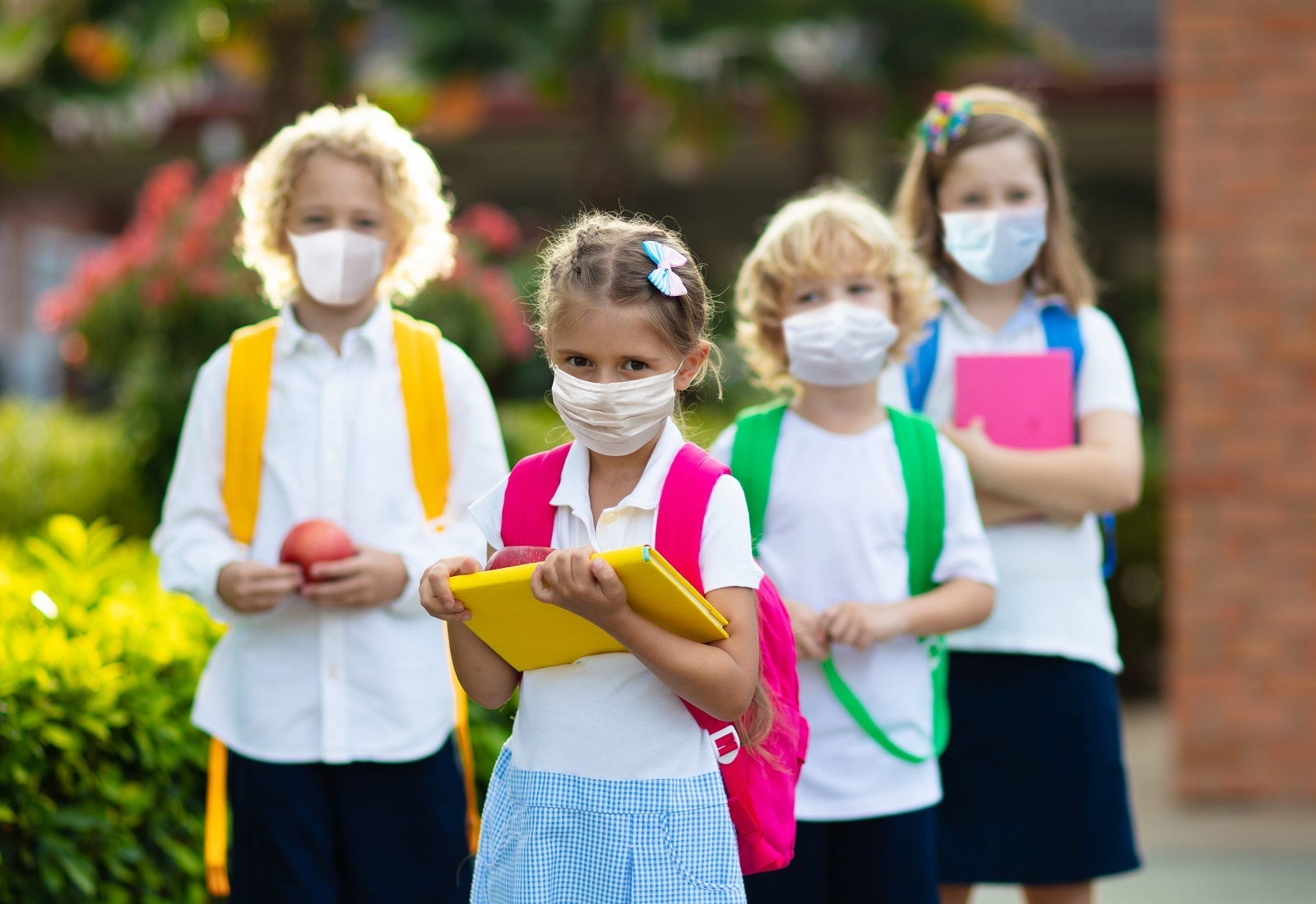School Child Wearing Face Mask During Corona Virus And Flu Outbr